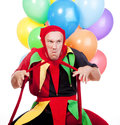 Jester with balloons Stock Photos