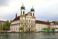 Jesuit church and waterfront lucerne switzerland buildings on of reuss river Royalty Free Stock Images