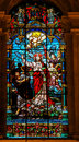 Jesus casting away lucifer in the desert stained glass window depicting cathedral of malaga spain Stock Image