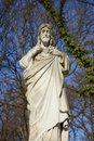 Jesus Christ ancient statue against a background of blue sky Royalty Free Stock Photo