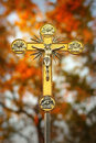 Jesus christ on cross beautiful glowing ornate golden crucifix of the with natural background Royalty Free Stock Images