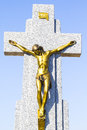 Jesus christ on the cross in a cemetery old with graves spanish holy place Royalty Free Stock Photos