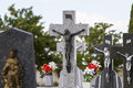 Jesus christ on the cross in a cemetery old with graves spanish holy place Stock Image