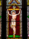 Jesus christ on the cross detail from a stained glass window depicting crucifixion of Royalty Free Stock Images