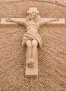 Jesus christ on the cross sand sculpture of crucified carved in a beach torrevieja alicante spain Stock Image