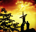 Jesus christ on the cross under fiery sky Royalty Free Stock Photo