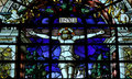 Jesus christ crucified stained glass window on the cross Stock Images