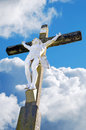 Jesus christ crucified statue of over a cloudy sky Stock Photo