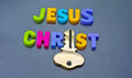 Jesus christ holds the key text in colorful uppercase letters with letter i replaced by a gold Royalty Free Stock Photography