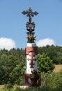 Jesus christ on old wayside orthodox cros cross in meadow Stock Photo