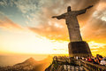 Jesus christ over rio de janeiro march tourists are happy to see the first sunset after a week of rain and thunderstorms on the Stock Image