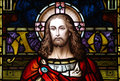 Jesus Christ in stained glass (the beginning and the end) Royalty Free Stock Photo