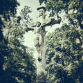 Jesus on the cross sculpture of retro stylized photo Stock Photos