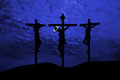 Jesus crucifixion silhouettes of the three crosses on a hill Stock Photos