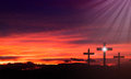 Jesus easter cross three crosses at sunset representing the crucifixion of Royalty Free Stock Image