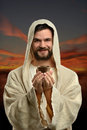 Jesus holding communion cup Imagem de Stock Royalty Free