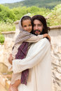 Jesus holding a little girl Royalty Free Stock Photo