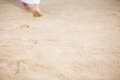 Jesus leaving footprints in sand Royalty Free Stock Photo