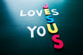 Jesus loves you conceptual words blackboard Stock Photos