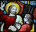 Jesus pointing to heaven. Stained glass window iconography Royalty Free Stock Photo