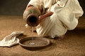 Jesus pouring water from a jaras a metaphore Stock Photos