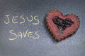 Jesus saves life in the picture a rosary iron placed over a heart of red wax on the left side the inscription made with a crayon Royalty Free Stock Image