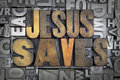 Jesus saves written in vintage letterpress type Stock Photo