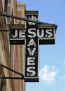 Jesus sign an unlit neon reading saves Stock Image