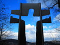 Jesus silhouette in cross toward heaven the of the picture taken towards rolling hills with a small town germany on the bottom of Stock Photos