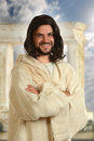 Jesus smiling portrait of with arms crossed with temple in background Royalty Free Stock Photography
