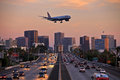Jet aircraft on landing approach flying low over city freeway british airways boeing crowded to land at lindberg field san diego Stock Photos