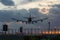 Jet Airplane Landing at Sunset Royalty Free Stock Photo