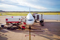 Jet Airplane parked at Airport taking Cargo and Passengers Royalty Free Stock Photo