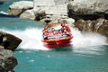 Jet boat in queenstown new zealand nz feb tourists enjoy a high speed ride on the shotover river on february Royalty Free Stock Photo