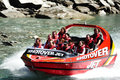 Jet boat in queenstown new zealand nz feb tourists enjoy a high speed ride on the shotover river on february Royalty Free Stock Image