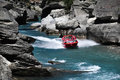 Jet boat in queenstown new zealand nz feb tourists enjoy a high speed ride on the shotover river on february Royalty Free Stock Photography