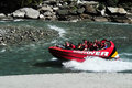 Jet boat in queenstown new zealand nz feb tourists enjoy a high speed ride on the shotover river on february Stock Image
