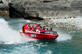 Jet boat in queenstown new zealand nz feb tourists enjoy a high speed ride on the shotover river on february Stock Photography