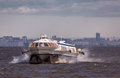 Jet boat travels through wavy Baltic water to Peterhof Royalty Free Stock Photo