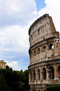 A jet and the colosseum flying near ancient nowadays in same picture Royalty Free Stock Photos