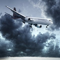 Jet is maneuvering in a stormy sky Stock Photo