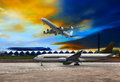 Jet plane flying over runways and beautiful dusky sky with copy Royalty Free Stock Photo