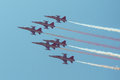 Jet plane formation on clear blue sky Stock Images