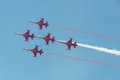 Jet plane formation on clear blue sky Stock Photos