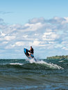 Jet ski jump an unidentified jetski enthusiast is driving his across big waves at the lake simcoe and using a wave as a ramp to Stock Image