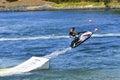 Jet Ski jumping over ramp Royalty Free Stock Photo