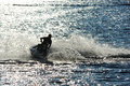 Jet ski man on turns fast on the water Royalty Free Stock Images