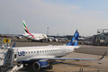 Jetblue embraer aircraft at the gate at the terminal and emirates airline airbus a at jfk international airport new york july john Stock Images