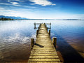 Jetty at the chiemsee in germany with blue sky Royalty Free Stock Photos