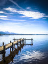 Jetty at the chiemsee in germany with blue sky Royalty Free Stock Photography
